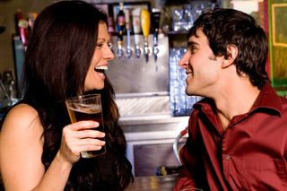 Woman-flirting-with-guy-in-bar(1)